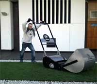 small man with big lawn mower